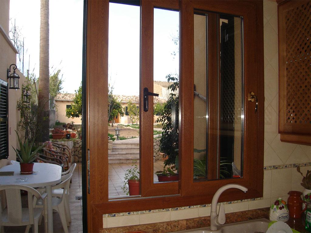 Ventas y puertas de alumnio folio madera ventavid for Ventanas de pvc tipo madera